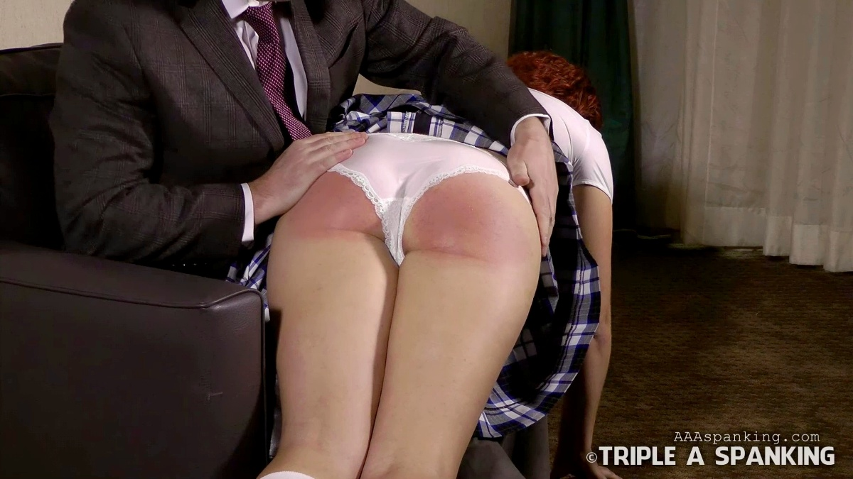 image Strapping and paddling for a sassy girl spanking