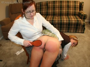 leather paddling of a bare sore bottom