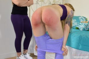 ass sore red and exposed from a hard spanking