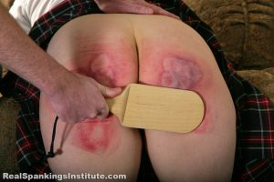 wooden paddle for a schoolgirl